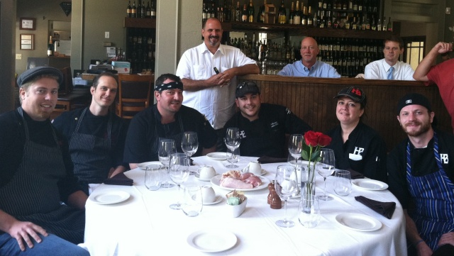 The teams from Passion 8 Bistro, on the left, and Heitz Brewery on the right with Competition Dining host and creator, Jimmy Crippen; as they learn the secret ingredient for the evening.