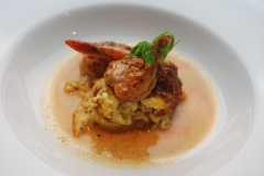 Hoppyum BBQ Shrimp, Country Ham Corn Pudding, Chili Oil, Curled Chives from Chef Brent Martin