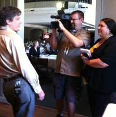 Technology expert and creator Derek Sanderson chats with the media - Michelle Boudin from WCNC