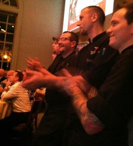 Chef watch as the scores for each dish are announced