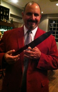 Jimmy Crippen wields the Ironman Forge chefs knife that went to Fire in the City Champ  Chef Jon Fortes