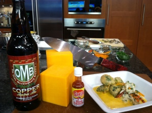 "Jon prepared his Copper Ale Beer cheese soup with beer battered broccoli and a crab salad with a beer vinaigrette all made with ""Good to be in NC"" products such as OMB Copper beer, Ashe county cheddar cheese and  Texas Pete hot sauce. The finished plates nd products are pictured here with the hand made Ironman Forge knife by Charlotte's own Steve Watkins. The knife was one of the prizes Jon won  competition champion!"
