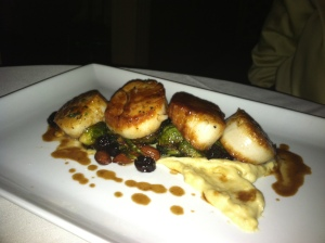 Wild caught U-10 scallops with parsnip puree, Brussels sprouts with cherries and almonds, bourbon and thyme demi