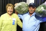 Mary and Ray Roberts-Tarlton with enough fresh picked certified organic spinach  to feed the crowd!