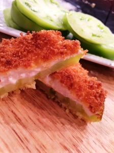 Spread green tomato slices with soft local South Carolina chevre from Fishing Creek Creamery in CHester SC or Clemson Blue Cheese from Clemson SC; and then proceed with the Master recipe for a cheesier version of fried green tomato flavor